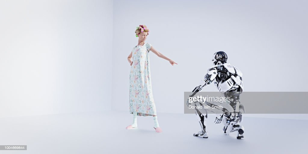 Older woman telling off robot : Photo