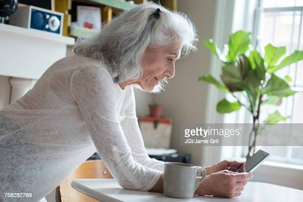 Older woman texting on cell phone