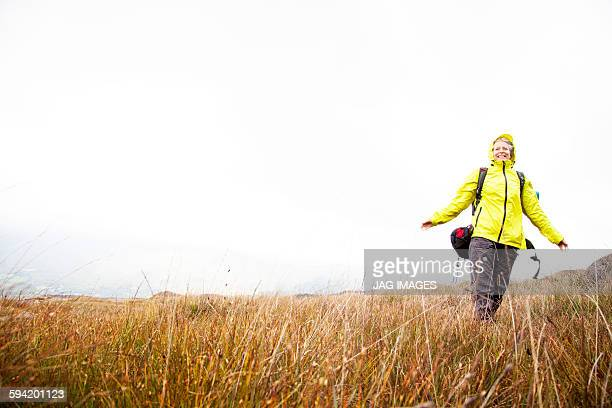 Older woman trekking in the mountains of ireland
