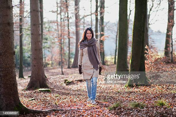 Older woman walking in forest