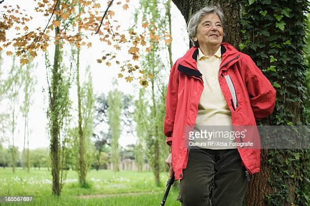 Older woman walking in park