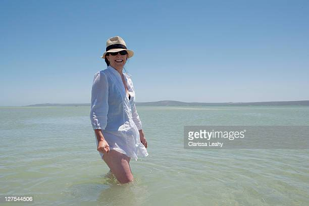 Older woman walking in water