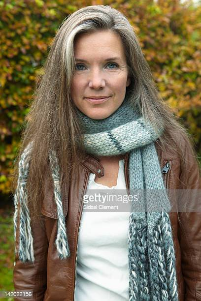 older woman wearing scarf outdoors - grey hair stock pictures, royalty-free photos & images