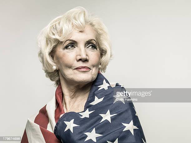 older woman wearing us flag - patriotism stock pictures, royalty-free photos & images