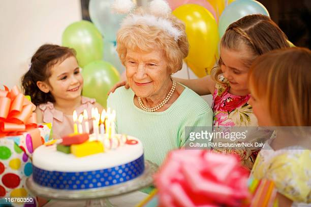 Older woman with girls at birthday party