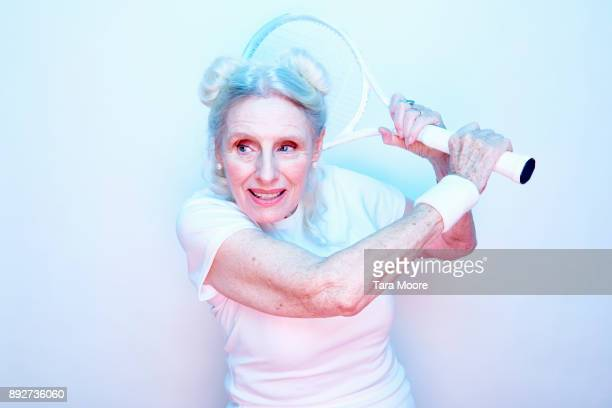 older woman with tennis racket