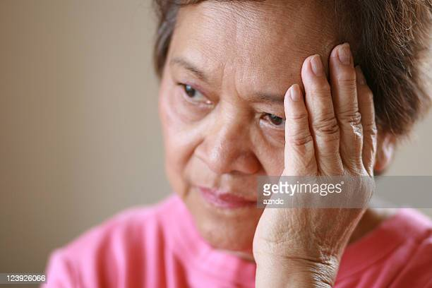 older woman worried about the future - abuse stock pictures, royalty-free photos & images