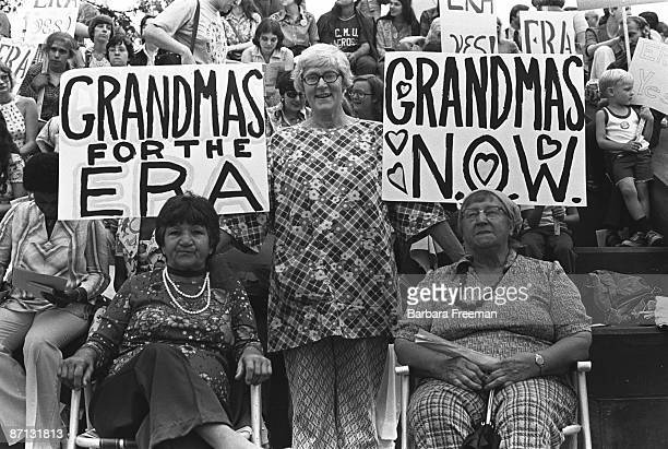 Older women gather at a demonstration in support of passage of the Equal Rights Amendment Pittsburgh PA 1976 Three foreground women's signs read...