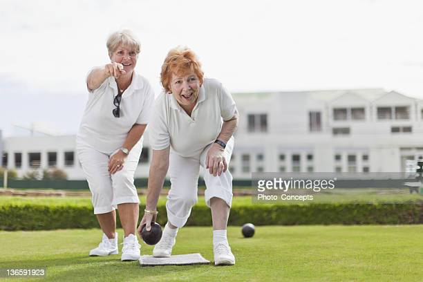 Older women playing lawn bowling