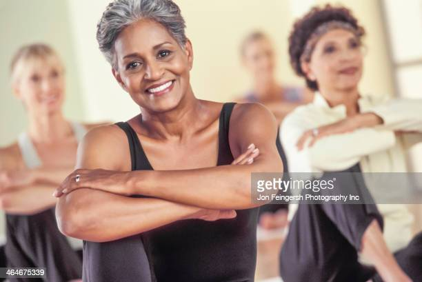 Older women stretching in exercise class