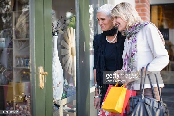 Older women window shopping together