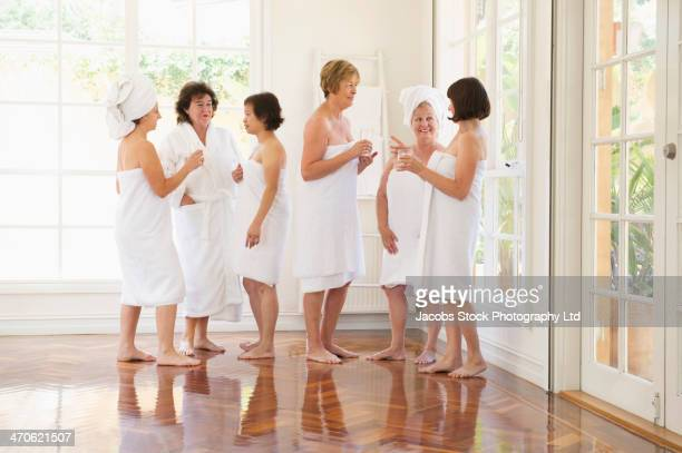 older women wrapped in towels talking in spa - wearing a towel stock pictures, royalty-free photos & images