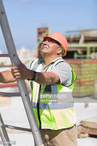 Older worker holding the ladder