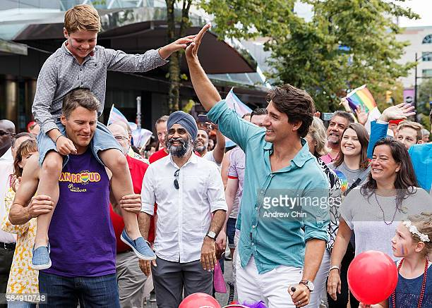 Oldest son Xavier James Trudeau high fives his dad Justin Trudeau Prime Minister of Canada while Ella-Grace Margaret Trudeau looks at her brother...