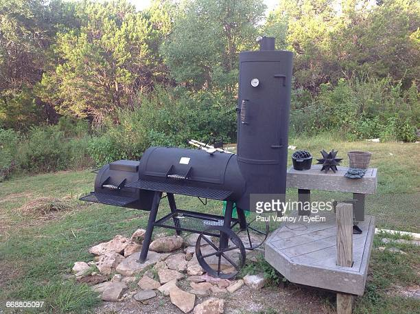 Old-Fashioned Barbecue On Grassy Field
