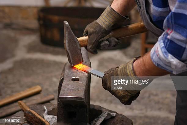 old-fashioned blacksmith making horseshoe - horseshoe stock pictures, royalty-free photos & images