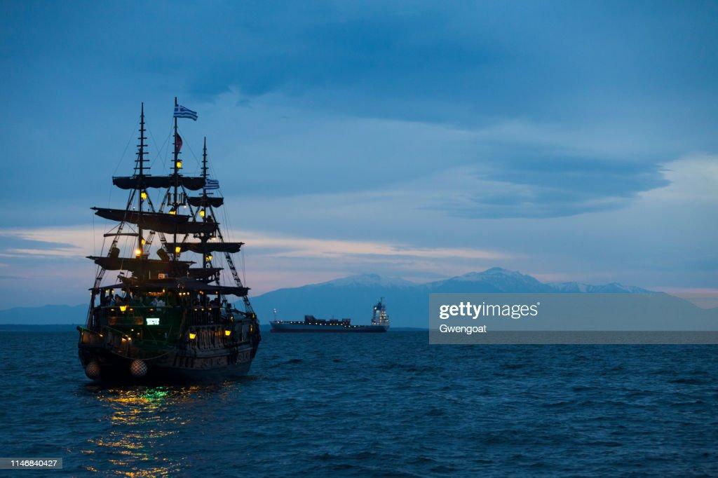 Old-fashioned boat on the Aegean Sea heading toward the Olympus Mount : Stock Photo