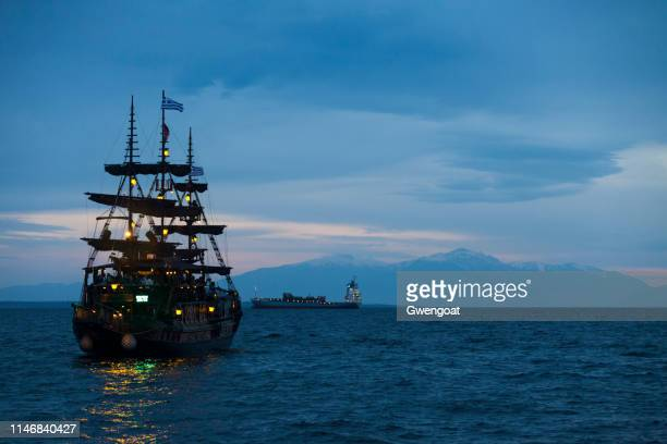 Old-fashioned boat on the Aegean Sea heading toward the Olympus Mount