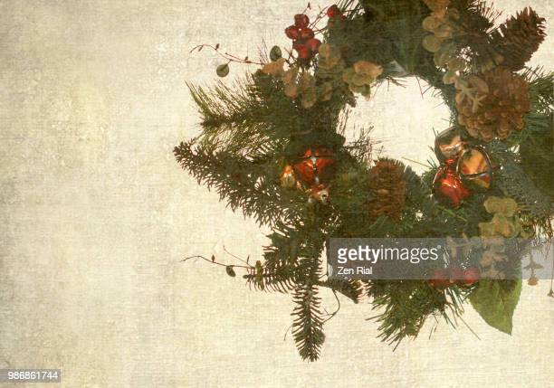 old-fashioned christmas wreath manipulated to have texture and copy space - country christmas stock pictures, royalty-free photos & images
