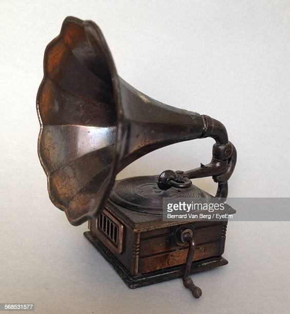 old-fashioned gramophone against white background - gramophone stock pictures, royalty-free photos & images