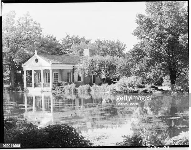 Oldfashioned house on a lake circa 1954 USA