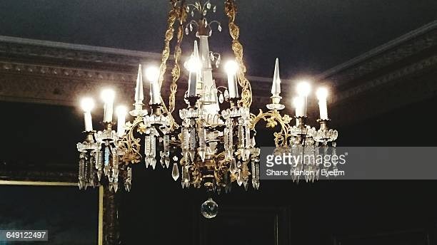 Old-Fashioned Illuminated Chandelier Hanging From Ceiling