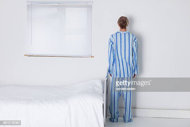 oldfashioned man in his stark bedroom - back to camera - human body part stock pictures, royalty-free photos & images