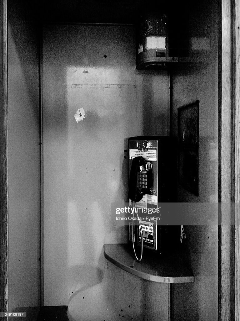 Oldfashioned Pay Phone At Telephone Booth Stock Photo