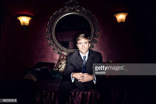 Old-fashioned portrait of a man in dark room