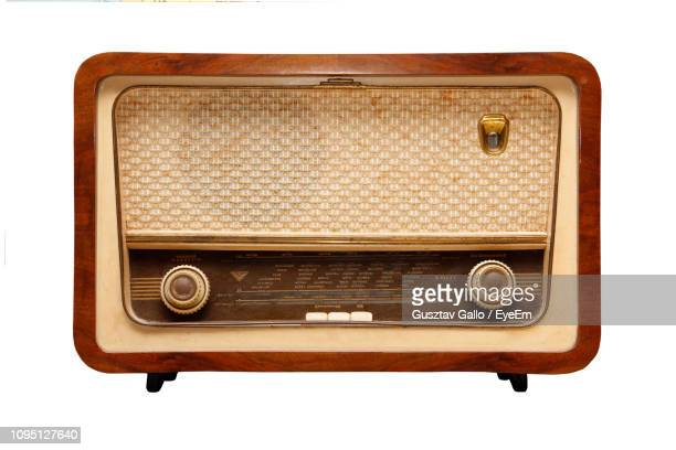 old-fashioned radio against white background - radio stock pictures, royalty-free photos & images