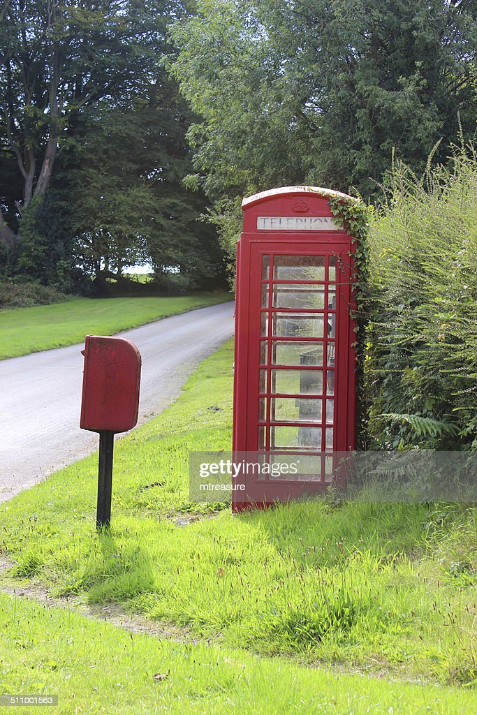 Oldfashioned Red Telephone Box In Countryside Village Phone