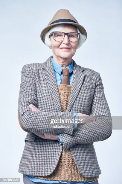 old-fashioned senior woman - checked suit stock pictures, royalty-free photos & images