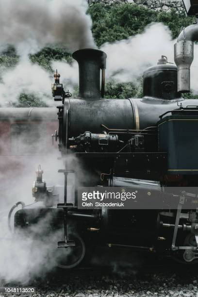 old-fashioned steam train in swiss alps - locomotive stock pictures, royalty-free photos & images