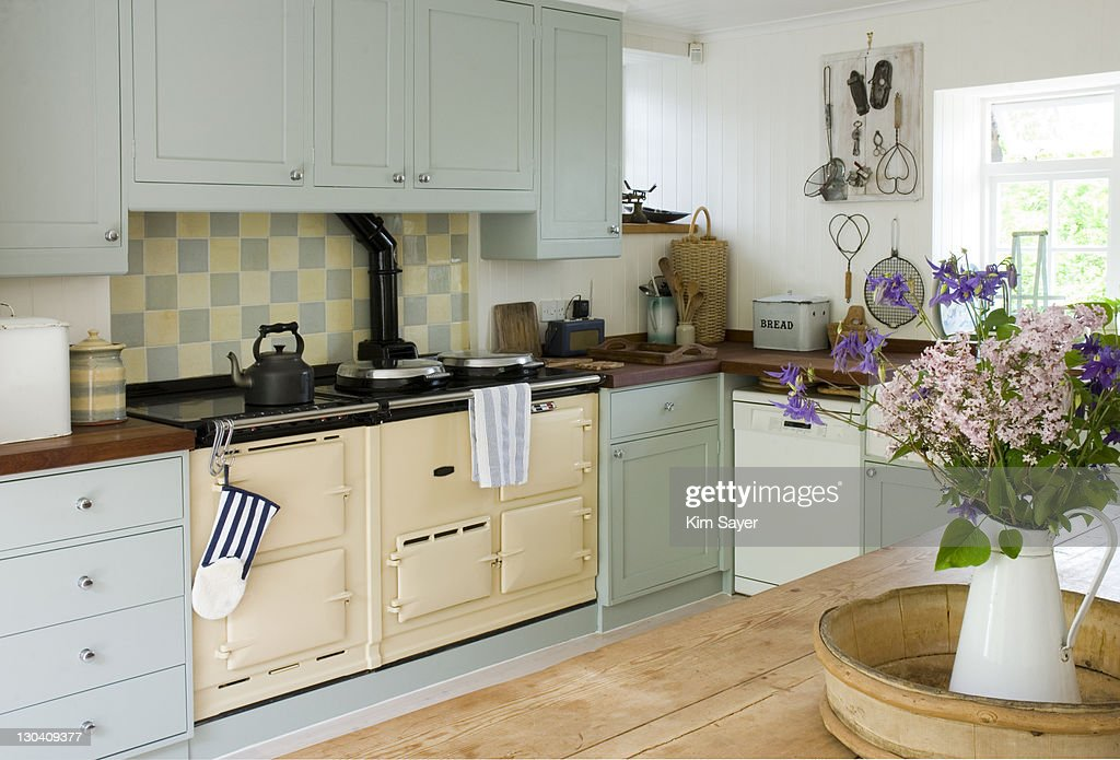 Old-fashioned stove in kitchen : Stock Photo