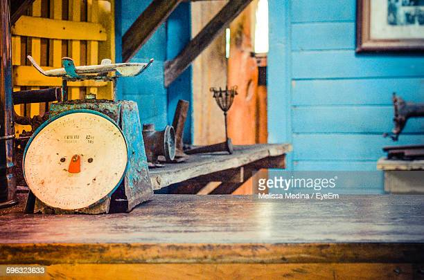 Old-Fashioned Weight Scale On Wooden Table