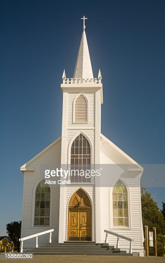 oldfashioned white church with steeple stock photo