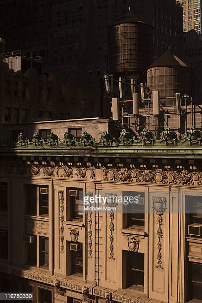 Old-fashioned wooden water storage tanks on the roof of a luxury apartment building, Manhattan