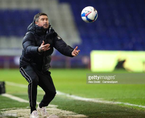 Oldham Athletic manager Harry Kewell throws a ball to his player during the Sky Bet League Two match between Oldham Athletic and Bolton Wanderers at...