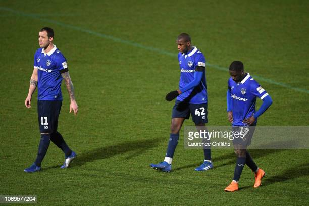 Oldham Athletic players look dejected following their sides defeat in during the FA Cup Fourth Round match between Doncaster Rovers and Oldham...