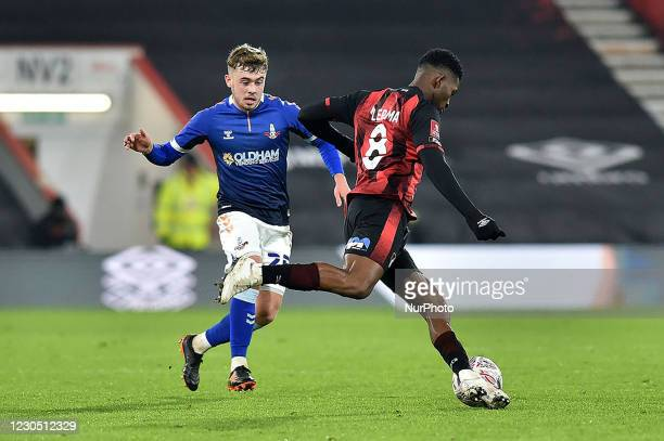 Oldham Athletic's Alfie McCalmont tussles with Jefferson Lerma of Bournemouth during the FA Cup match between Bournemouth and Oldham Athletic at the...