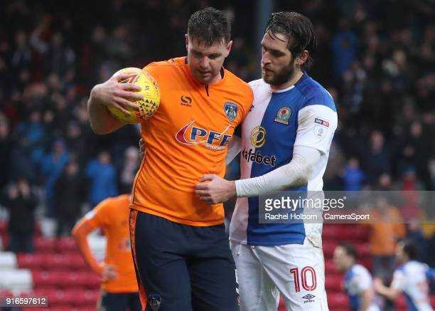 Oldham Athletic's Anthony Gerrard keeps the ball away from Blackburn Rovers' Danny Graham after the equalising goal during the Sky Bet League One...