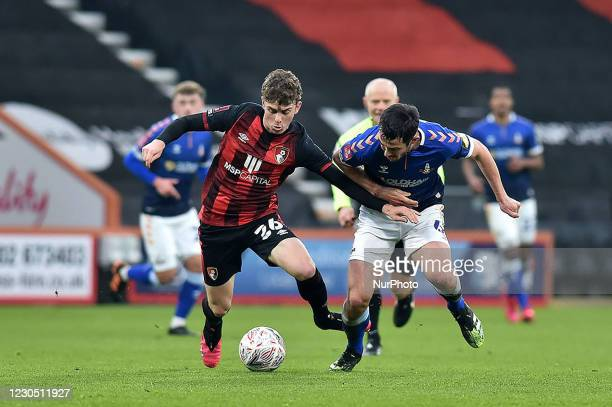 Oldham Athletic's Ben Garrity tussles with Gavin Kilkenny of Bournemouth during the FA Cup match between Bournemouth and Oldham Athletic at the...