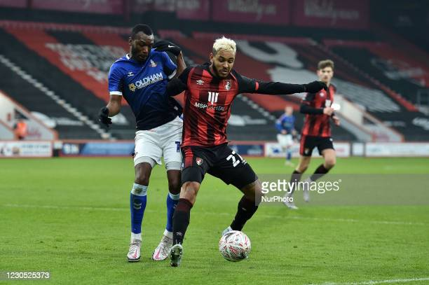 Oldham Athletic's Brice Ntambwe tussles with Joshua King of Bournemouth during the FA Cup match between Bournemouth and Oldham Athletic at the...
