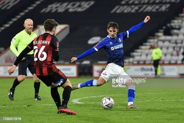 Oldham Athletic's Callum Whelan shoots ahead of Gavin Kilkenny of Bournemouth l during the FA Cup match between Bournemouth and Oldham Athletic at...