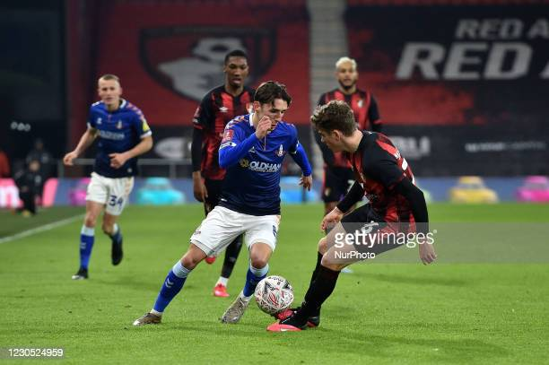 Oldham Athletic's Callum Whelan tussles with Gavin Kilkenny of Bournemouth during the FA Cup match between Bournemouth and Oldham Athletic at the...