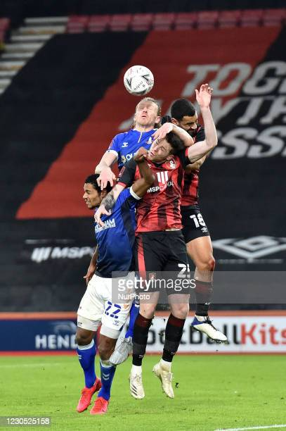 Oldham Athletic's Carl Piergianni and Oldham Athletic's Raphaël Diarra tussles with Jack Simpson of Bournemouth during the FA Cup match between...
