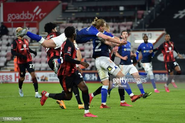 Oldham Athletic's Carl Piergianni tussles with Philip Billing of Bournemouth during the FA Cup match between Bournemouth and Oldham Athletic at the...