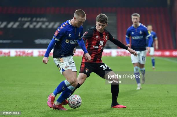 Oldham Athletic's Davis Keillor-Dunn tussles with Gavin Kilkenny of Bournemouth during the FA Cup match between Bournemouth and Oldham Athletic at...