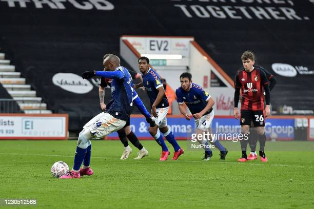 Oldham Athletic's Dylan Bahamboula scores a penalty during the FA Cup match between Bournemouth and Oldham Athletic at the Vitality Stadium,...