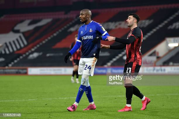 Oldham Athletic's Dylan Bahamboula tussles with Diego Rico of Bournemouth during the FA Cup match between Bournemouth and Oldham Athletic at the...